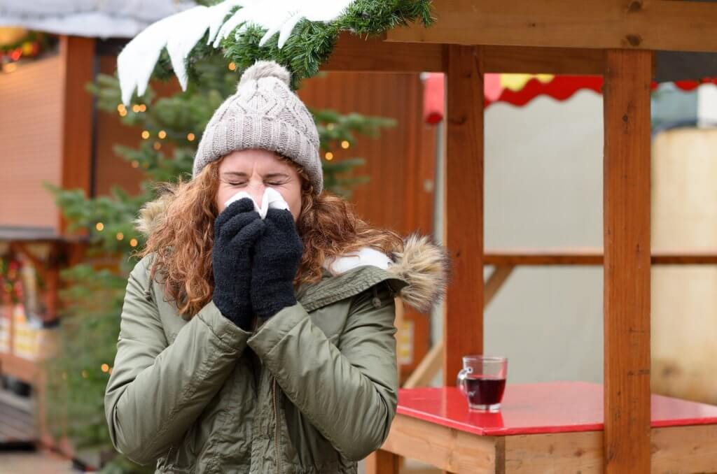 Woman Sneezing Because of winter allergies